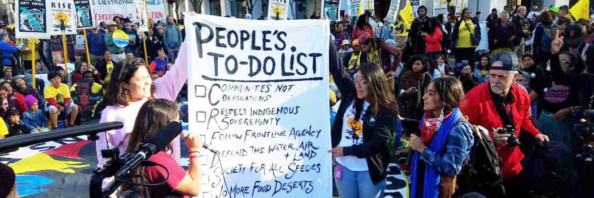 "Activists hold up ""The People's To-Do List"""