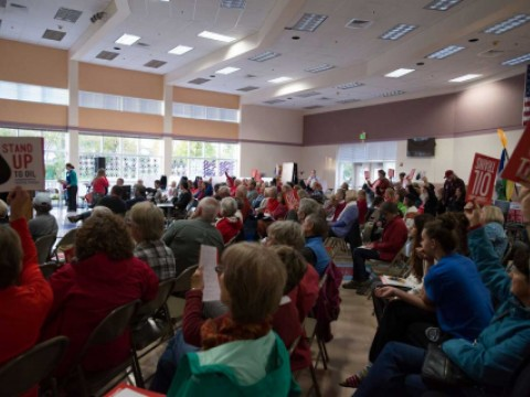 Local residents pack a town hall meeting in opposition to Shell's proposed oil train project