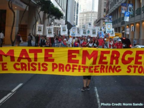 Protesters stand with a climate emergency banner on Montgomery street in San Francisco