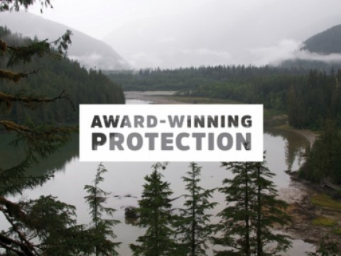 "Graphic saying ""Award Winning Protection"" with image of Great Bear Rainforest in the background"