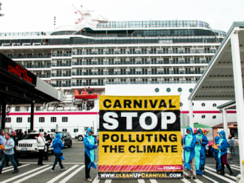 "Plant for the Planet student ambassadors donned polar bear costumes and kicked off the Alaska cruise season by greeting Carnival passengers in Seattle with a giant banner reading, ""Carnival Stop Polluting the Climate."""