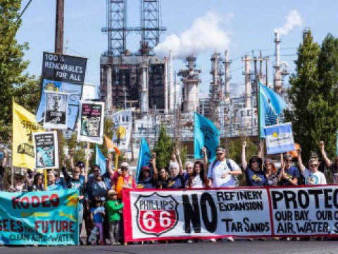 Opponents of tar sands rally in front of the Phillips 66 refinery in Rodeo