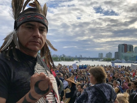 Will George in Indigenous wear at a Trans Mountain rally
